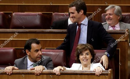 Candidates for the Presidency of People's Party, former Deputy Prime Minister Soraya Saez de Santamaria (R, front) and Pablo Casado (rear), arrive for an extraordinary session at the Lower Chamber in the Spanish Parilament, in Madrid, Spain, 17 July 2018. Spanish Prime Minister, Pedro Sanchez (unseen), has informed the Members in Parliament on his governmental program and briefed on the results of the recent European Council meeting.