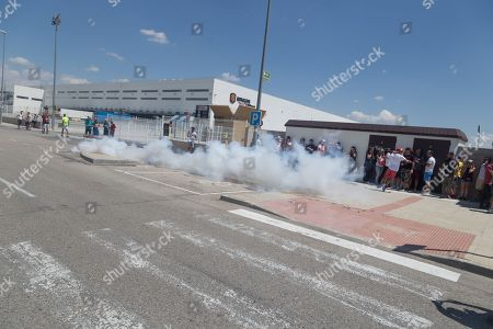 Strikers throw firecrackers during the strike