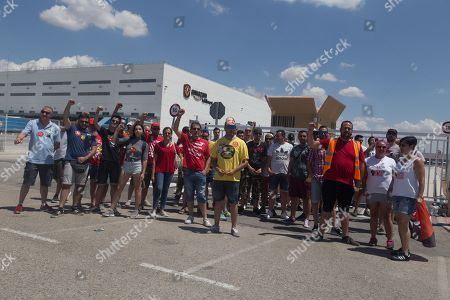 Strikers protest at one of the warehouse truck entrances during the strike