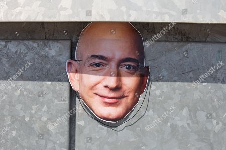 Mask of Jeff Bezos, owner of Amazon, seen during the strike