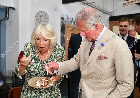 Camilla Duchess of Cornwall and Prince Charles eating her birthday cake in 'On the Quay' restaurant on St Mary's Island
