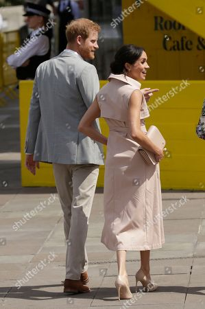 Britain's Prince Harry, leftand his wife Meghan the Duchess of Sussex arrive for their visit to the launch of the Nelson Mandela Centenary Exhibition, marking the 100th anniversary of anti-apartheid leader's birth, at the Queen Elizabeth Hall in London