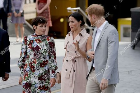 Britain's Prince Harry, right, and his wife Meghan the Duchess of Sussex arrive for their visit to the launch of the Nelson Mandela Centenary Exhibition, marking the 100th anniversary of anti-apartheid leader's birth, at the Queen Elizabeth Hall in London
