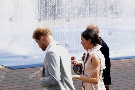 Britain's Prince Harry foreground and his wife Meghan the Duchess of Sussex arrive for the launch of the Nelson Mandela Centenary Exhibition, marking the 100th anniversary of anti-apartheid leader's birth, at the Queen Elizabeth Hall in London