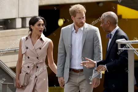 Britain's Prince Harry centre and his wife Meghan the Duchess of Sussex talk with the Lord-Lieutenant of Greater London, Sir Kenneth Olisa as they arrive for the launch of the Nelson Mandela Centenary Exhibition, marking the 100th anniversary of anti-apartheid leader's birth, at the Queen Elizabeth Hall in London