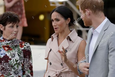 Britain's Prince Harry, right, and his wife Meghan the Duchess of Sussex arrive for the launch of the Nelson Mandela Centenary Exhibition, marking the 100th anniversary of anti-apartheid leader's birth, at the Queen Elizabeth Hall in London