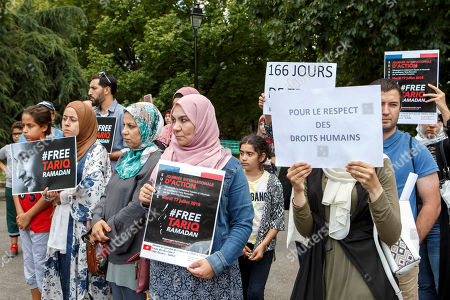 Women hold placards with writing 'Free Tariq Ramadan', '166 days too much!' and 'For Respect for Human Rights', during a rally in support of Islamic scholar Tariq Ramadan, in front of French consulate in Geneva, Switzerland, 17 July 2018. Tariq Ramadan is detained in France on alleged sexual harassment and rape charges. Ramadan is detained for questioning in Paris, months after women filed rape charges or sexual assault against him in France. Ramadan has denied the allegations.
