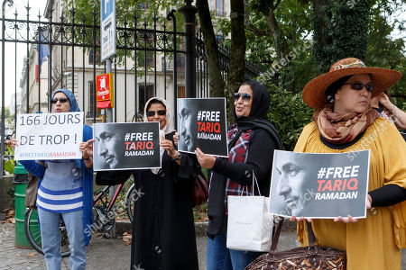 Women hold placards with writing 'Free Tariq Ramadan' and '166 days too much!', during a rally in support of Islamic scholar Tariq Ramadan, in front of French consulate in Geneva, Switzerland, 17 July 2018. Tariq Ramadan is detained in France on alleged sexual harassment and rape charges. Ramadan is detained for questioning in Paris, months after women filed rape charges or sexual assault against him in France. Ramadan has denied the allegations.