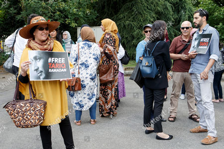 Women hold placards with writing 'Free Tariq Ramadan', during a rally in support of Islamic scholar Tariq Ramadan, in front of French consulate in Geneva, Switzerland, 17 July 2018. Tariq Ramadan is detained in France on alleged sexual harassment and rape charges. Ramadan is detained for questioning in Paris, months after women filed rape charges or sexual assault against him in France. Ramadan has denied the allegations.
