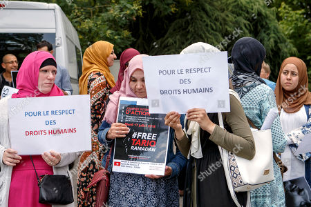 Women hold placards with writing 'Free Tariq Ramadan' and 'For Respect for Human Rights', during a rally in support of Islamic scholar Tariq Ramadan, in front of French consulate in Geneva, Switzerland, 17 July 2018. Tariq Ramadan is detained in France on alleged sexual harassment and rape charges. Ramadan is detained for questioning in Paris, months after women filed rape charges or sexual assault against him in France. Ramadan has denied the allegations.