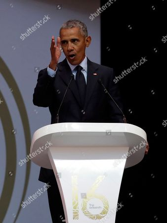 U.S. President Barack Obama delivers his speech at the 16th Annual Nelson Mandela Lecture at the Wanderers Stadium in Johannesburg, South Africa, . In his highest-profile speech since leaving office, Obama urged people around the world to respect human rights and other values under threat in an address marking the 100th anniversary of anti-apartheid leader Nelson Mandela's birth