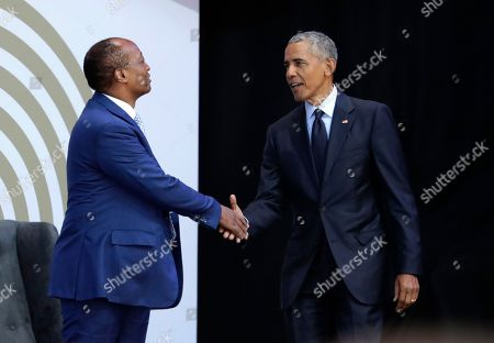 Former US President Barack Obama, right, shakes hands with Patrice Motsepe, as he arrives at the Wanderers Stadium in Johannesburg, South Africa, to deliver the 16th Annual Nelson Mandela Lecture. Obama urged Africans and people around the world to respect human rights and equal opportunity in his speech to mark the late Nelson Mandela's 100th birthday