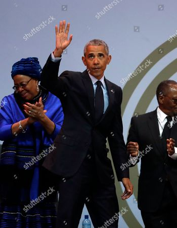 Former U.S. President Barack Obama, waves as he leaves the stage after delivering his speech at the 16th Annual Nelson Mandela Lecture at the Wanderers Stadium in Johannesburg, South Africa, . In his highest-profile speech since leaving office, Obama urged people around the world to respect human rights and other values under threat in an address marking the 100th anniversary of anti-apartheid leader Nelson Mandela's birth