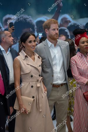 Britain's Prince Harry and Meghan the Duchess of Sussex attend the launch of the Nelson Mandela Centenary Exhibition, marking the 100th anniversary of anti-apartheid leader's birth, at the Queen Elizabeth Hall in London