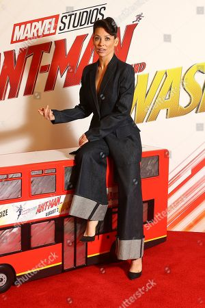 Evangeline Lily poses for photographers upon a model bus arrival at the photo call of the film 'Ant Man and The Wasp', in a central London hotel