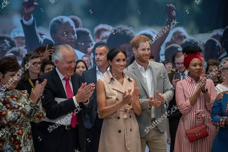 Britain's Prince Harry, second right, and Meghan the Duchess of Sussex attend the launch of the Nelson Mandela Centenary Exhibition, marking the 100th anniversary of anti-apartheid leader's birth, at the Queen Elizabeth Hall in London