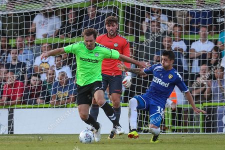 Forest Green Rovers Scott Laird(3) beats Leeds United's Ezgjan Alioski(10) to the ball during the Pre-Season Friendly match between Forest Green Rovers and Leeds United at the New Lawn, Forest Green. Picture by Shane Healey