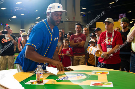 """Former MLB All-Stars Cal Ripken Jr. and Cliff Floyd battled for the title of """"Flip for Flavor"""" champion at Snapple's first-ever All-Star Bottle Flip Challenge at FanFest where the players accurately flipped Snapple bottles onto fruit bases resembling a baseball diamond, in Washington"""