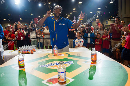 "Stock Photo of Cliff Floyd won Snapple's first-ever All-Star Bottle Flip Challenge at MLB FanFest where he competed against Cal Ripken Jr. for the prestigious ""Flip for Flavor"" champion title, in Washington"