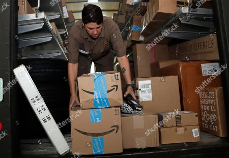UPS employee Liz Perez unloads packages for delivery in Miami, . Amazon Prime Day was launched July 16 and and will be six hours longer than last year's and will launch new products
