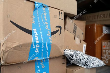 Amazon Prime packages sit in an UPS delivery truck before being unloaded in Miami, . Amazon Prime Day was launched July 16 and and will be six hours longer than last year's and will launch new products