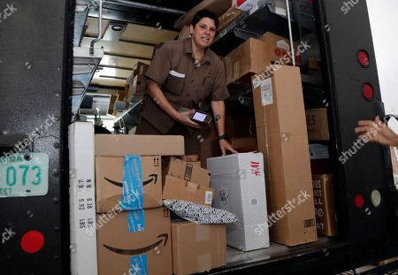 UPS employee Liz Perez scans packages for delivery in Miami, . Amazon Prime Day was launched July 16 and and will be six hours longer than last year's and will launch new products