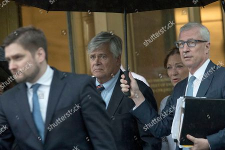 Dean Skelos, Gail Skelos. Dean Skelos, center, and his wife Gail, second from right, leave federal court, in New York. The former New York state Senate leader, and his son Adam, were convicted Tuesday of bribery and extortion charges at their federal corruption trial