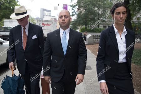 Adam Skelos, center, leaves federal court, in New York. Dean Skelos, the former New York state Senate leader, and his son Adam were convicted on Tuesday of extortion, wire fraud and bribery charges of pressuring businesses to give the son no-show jobs or else risk losing the powerful Republican's political support