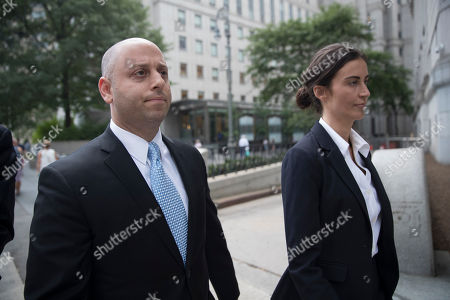 Adam Skelos, left, leaves federal court, in New York. Dean Skelos, the former New York state Senate leader, and his son Adam were convicted on Tuesday of extortion, wire fraud and bribery charges of pressuring businesses to give the son no-show jobs or else risk losing the powerful Republican's political support
