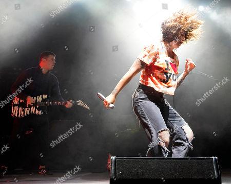 Derek E. Milller, Alexis Krauss. The American noise pop band Sleigh Bells with guitarist Derek E. Miller and front woman Alexis Krauss performs at the Xfinity Center, in Mansfield, Mass