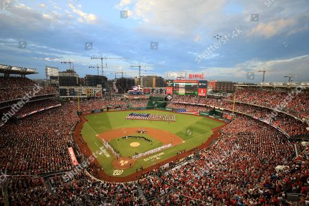 Stock Photo of A general view of the people standing for the US National Anthem at the start of the 89th MLB All-Star Game at Nationals Park in Washington DC, USA, 17 July 2018.
