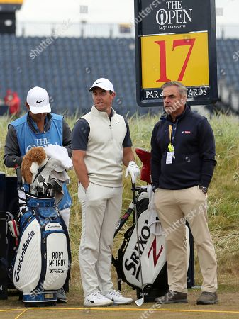Rory McIlroy of Northern Ireland talks to Paul McGinley, right, on the 17th tee box during a practice round ahead of the British Open Golf Championship in Carnoustie, Scotland