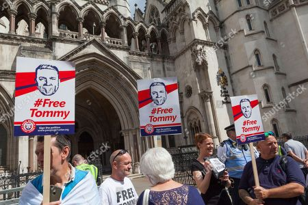 Stock Photo of FreeTommy supporters gather outside London's Royal Courts of Justice to show solidarity with far-right activist Tommy Robinson, who's appeal against his recent imprisonment is due to be heard by Lord Justice Leveson. Sir Brian Henry Leveson is currently the President of the Queen's Bench Division and Head of Criminal Justice in the UK.