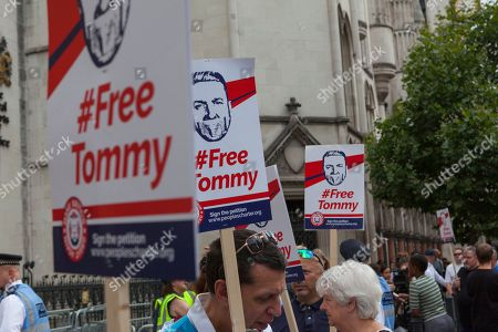 Stock Image of FreeTommy supporters gather outside London's Royal Courts of Justice to show solidarity with far-right activist Tommy Robinson, who's appeal against his recent imprisonment is due to be heard by Lord Justice Leveson. Sir Brian Henry Leveson is currently the President of the Queen's Bench Division and Head of Criminal Justice in the UK.