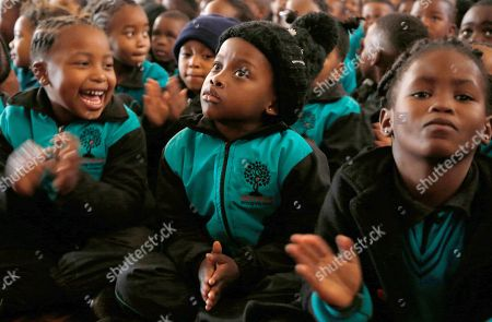 Children attend a special assembly to mark Mandela Day, at Melpark Primary School, in Johannesburg, . South Africans, along with former U.S. President Barack Obama, are marking the centennial of Nelson Mandela's birth with acts of charity in a country still struggling with deep economic inequality 24 years after the end of white minority rule