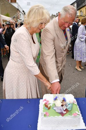 Stock Photo of Camilla Duchess of Cornwall and Prince Charles at the 'Gate-to-Plate' food market, meeting residents and local producers, Honiton