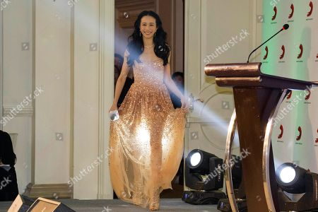 Hong Kong singer-actress Karen Mok arrives for a signing ceremony to launch her new music label co-created with Sony Music in Beijing, China