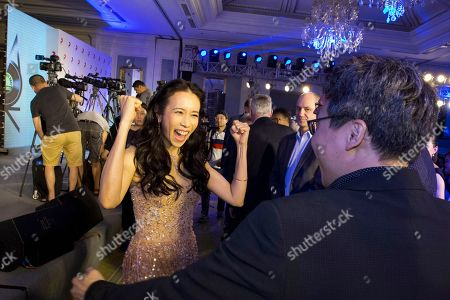 Hong Kong singer-actress Karen Mok reacts at the end of a press conference to launch her new music label co-created with Sony Music in Beijing, China