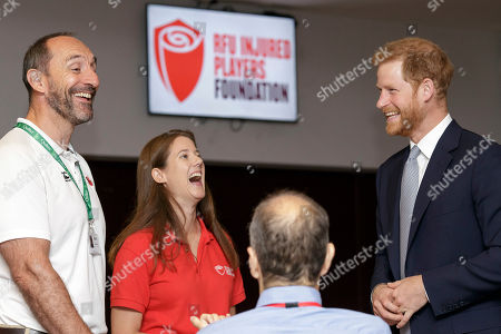 Britain's Prince Harry, Duke of Sussex, smiles as he talks with Karen Hood, head of the Injured Players Foundation (IPF), and Dean Holder, IPF welfare officer, during a visit to the RFU Injured Players Foundation's annual Client Forum at Twickenham Stadium, in London, . The RFU Injured Players Foundation provides information and support to players who sustain catastrophic injury, and uses research and education to help prevent future injuries