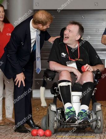 Britain's Prince Harry, Duke of Sussex, meets with boccia player Russell Clarke from London, during a visit to the RFU Injured Players Foundation's annual Client Forum at Twickenham Stadium, in London, . The RFU Injured Players Foundation provides information and support to players who sustain catastrophic injury, and uses research and education to help prevent future injuries
