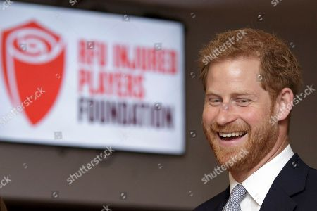 Britain's Prince Harry, Duke of Sussex, smiles during a visit to the RFU Injured Players Foundation annual Client Forum at Twickenham Stadium, in London, . The RFU Injured Players Foundation provides information and support to players who sustain catastrophic injury, and uses research and education to help prevent future injuries