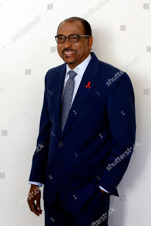 Embattled UNAIDS chief Michel Sidibe poses for photographers before attending a press conference, in Paris, France, . Sidibe has said he will not quit his job over criticism of his handling of sexual harassment allegations at the Geneva-based agency