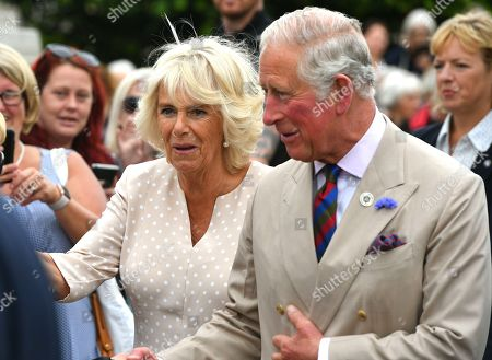 Prince Charles and Camilla Duchess of Cornwall visit Honiton, Devon, to attend the town's 'Gate-to-Plate' food market, meeting residents and local producers.