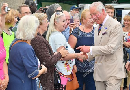 Prince Charles meets local residents as he visits the 'Gate-to-Plate' food market in Honiton, Devon.
