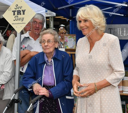 Camilla Duchess of Cornwall poses for a photograph with Margaret Hine, 81, as she visits the 'Gate-to-Plate' food market in Honiton, Devon.