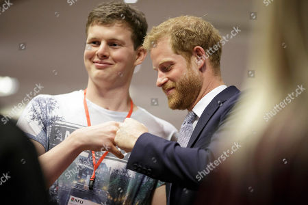 Prince Harry, meets with Injured Players Foundation (IPF) member Sam Harrison during a visit to the RFU Injured Players Foundation's annual Client Forum at Twickenham Stadium, in London