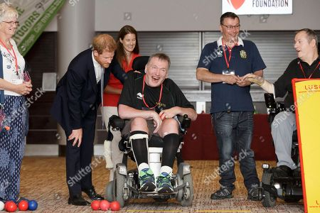 Stock Image of Prince Harry, left, speaks with boccia players Russell Clarke from London, and Alan Douglas from Nottingham, right, during a visit to the RFU Injured Players Foundation's annual Client Forum at Twickenham Stadium, in London