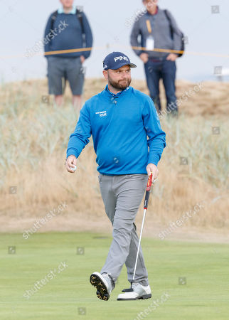 Andy Sullivan of England on the first green