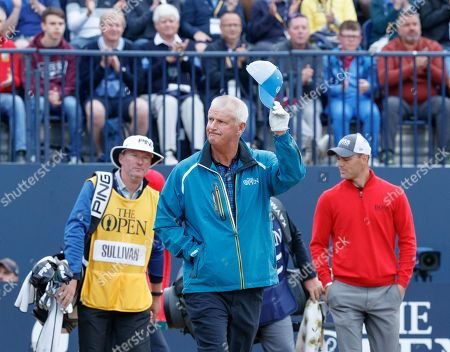 Sandy Lyle (SCO) raises his cap to the crowd after playing the first tee shot of the 147th Open Championship at 06:35