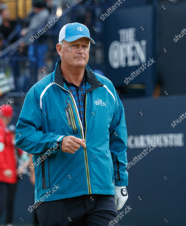 Sandy Lyle (SCO) on the first hole after playing the first tee shot of the 147th Open Championship at 06:35